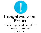 busty model in green bikini